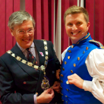 Mayor Tim Dodds and Buttons compare their finery before on press night.