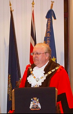 The Mayor in his council chambers.